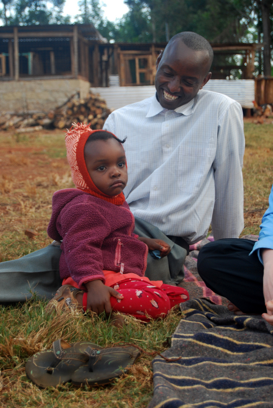 Geoffrey, Director of the WWB orphanage, with one of the children