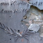 Damaged tombstone of the Old Jewish cemetery