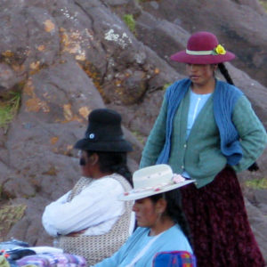 Women of Sillustani. Beautiful, age-defying, black hair similar to Tibetan women. Peruvian women dressed in stylish layered clothing also similar to Tibetan women; however, not quite the same style nor vibrancy in colors.