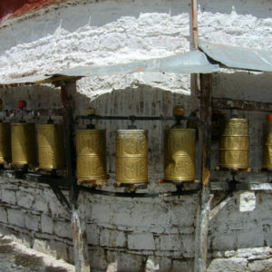 Prayer wheels contain old scriptures. When one passes by and spins the wheel, this action is equivalent to reciting the mantra.