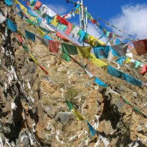Prayer flags blesses these Tibetan mountains.