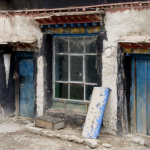 """Blue Doors"" in Shigatse, Tibet. A house along the side of the road."