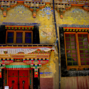 """Symphony Coloric"" - colorful designs and murals. The exterior design of a monastery. This is a great example of how Tibetan buildings serve as canvases for their art."