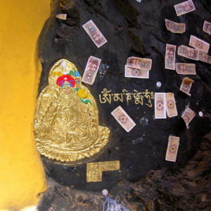 Another corner of Tibet that had a poetic design. This site was found in a cave in Lhasa, Tibet. The yellow wall matched Buddha's golden skin, and the coins and bills contrasted with the Buddha.