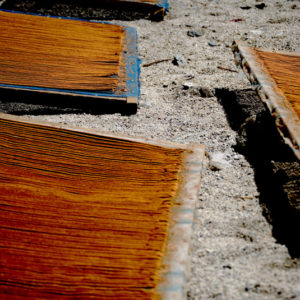 These filters contained wooden residues that were purified in an incense factory. The incense was then laid out in front of a Tibetan home to dry.