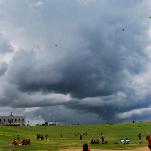 Flying kites at the field of Fortress El Morro